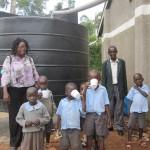 The children enjoy the clean raining water.