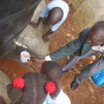 The children drink very excited the first fresh raining water